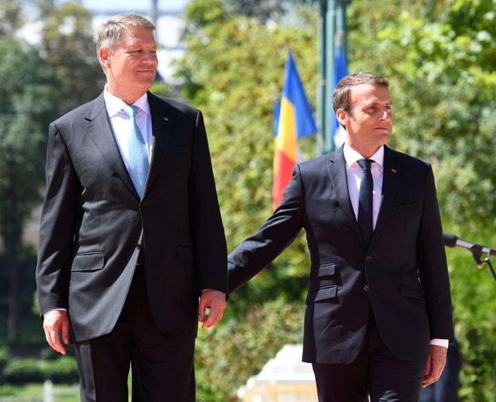 Iohannis (l.) und Macron