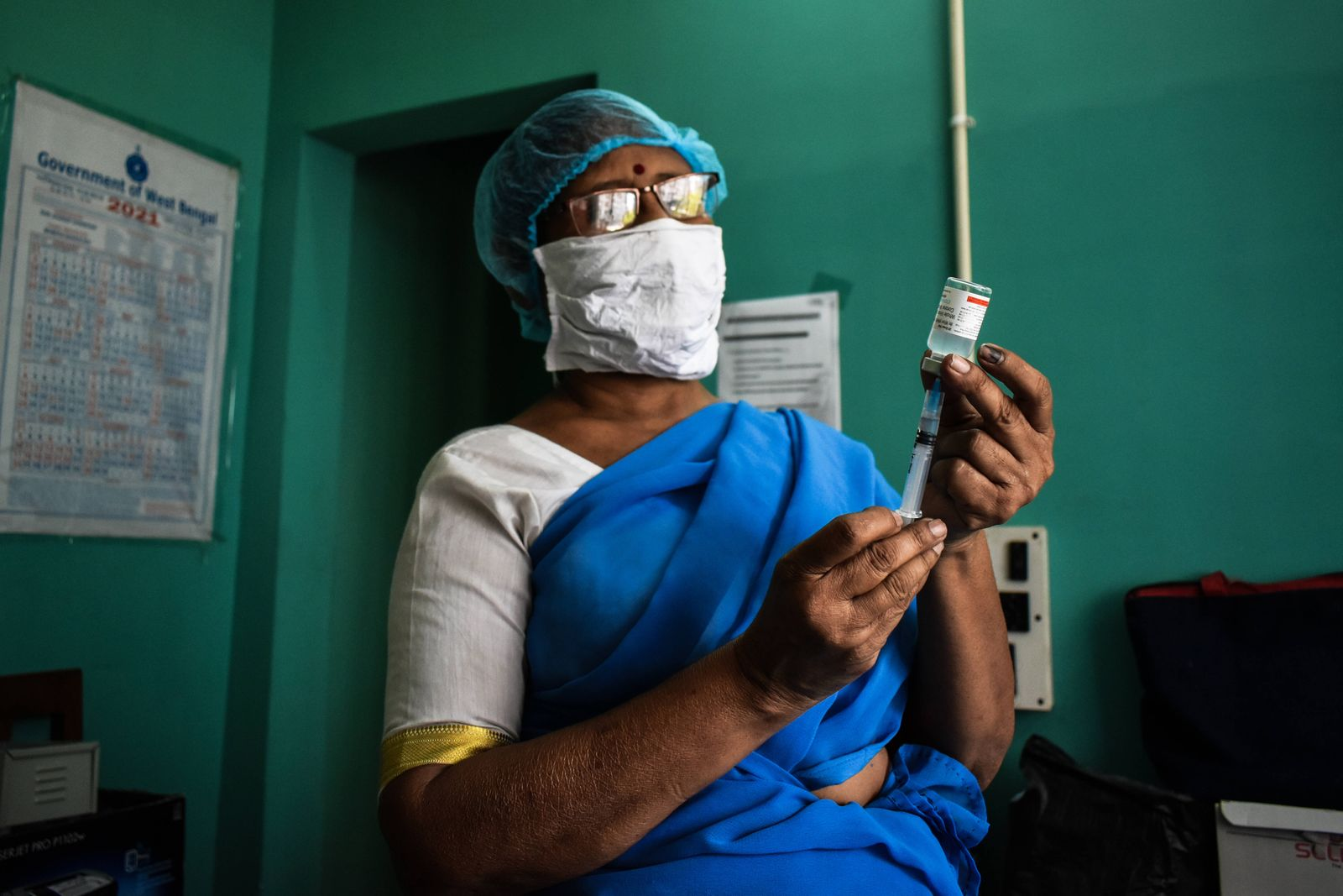 Vaccine crisis in Kolkata A Health worker prepares a dose of Covaxin (Vaccine of Corona Virus) inside on a West Bengal