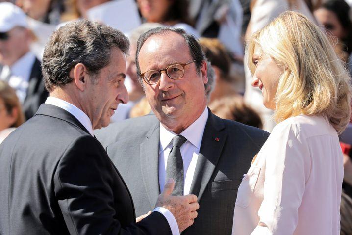 Ex-Präsident François Hollande (M.) mit seinem Vorgänger Nicolas Sarkozy