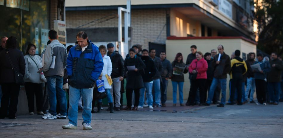 People waiting at an employment office in Spain.