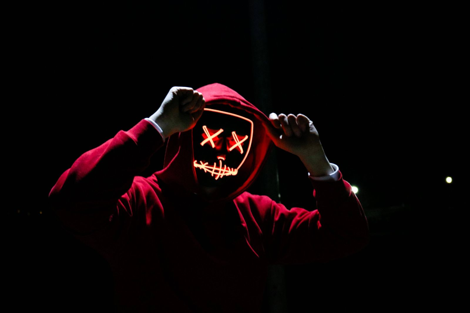 A Man Wearing A Red Hoodie With Red Glowing Mask In The Dark Backgroun Washington, DC, United States PUBLICATIONxINxGER