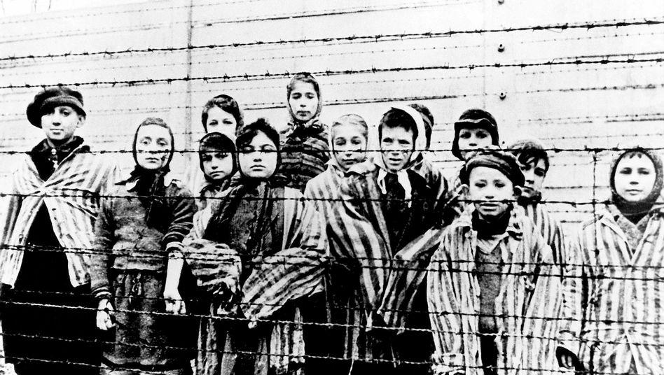 Survivors of the Auschwitz death camp in 1945.
