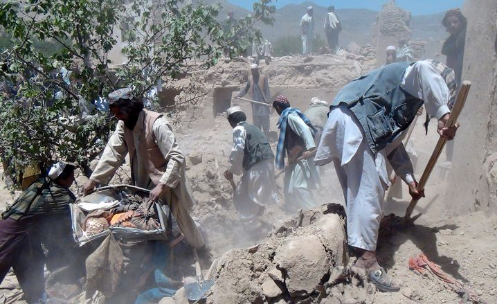 """Villagers looking for dead family members following a NATO strike in 2012 in the Logar province: """"The U.S. was supporting both sides of the conflict at the same time."""""""