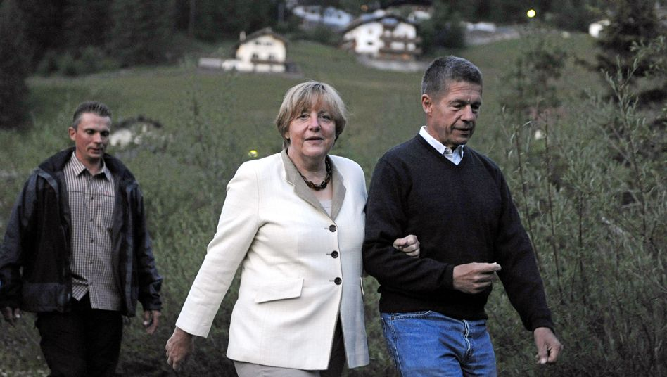 German Chancellor Angela Merkel and her husband Joachim Sauer (right) are currently vacationing in Italy's South Tyrol region.