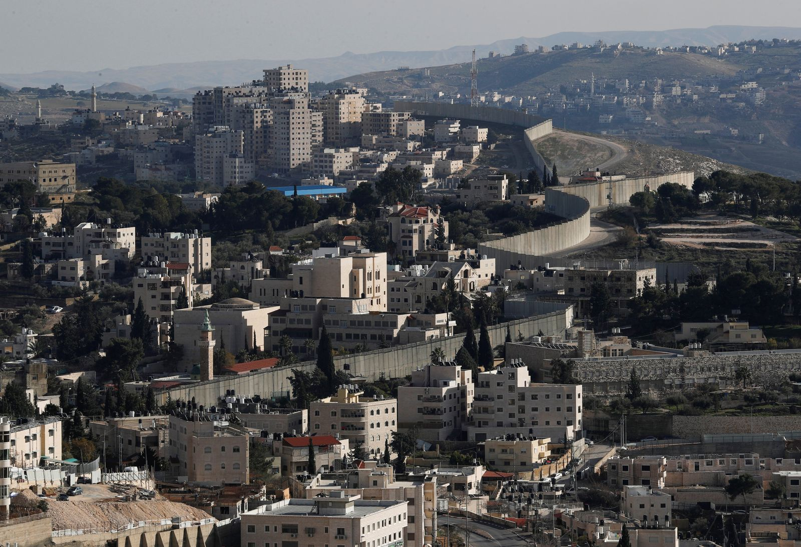 A general view shows the Israeli barrier at the Palestinian town of Abu Dis in the Israeli-occupied West Bank east of Jerusalem