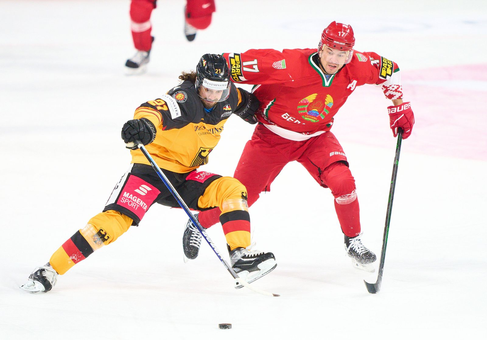 Nikolas KRÄMMER, DEB 21 compete, fight for the puck against Francic PARE, BLR 17 at the match GERMANY - BELARUS Friendl