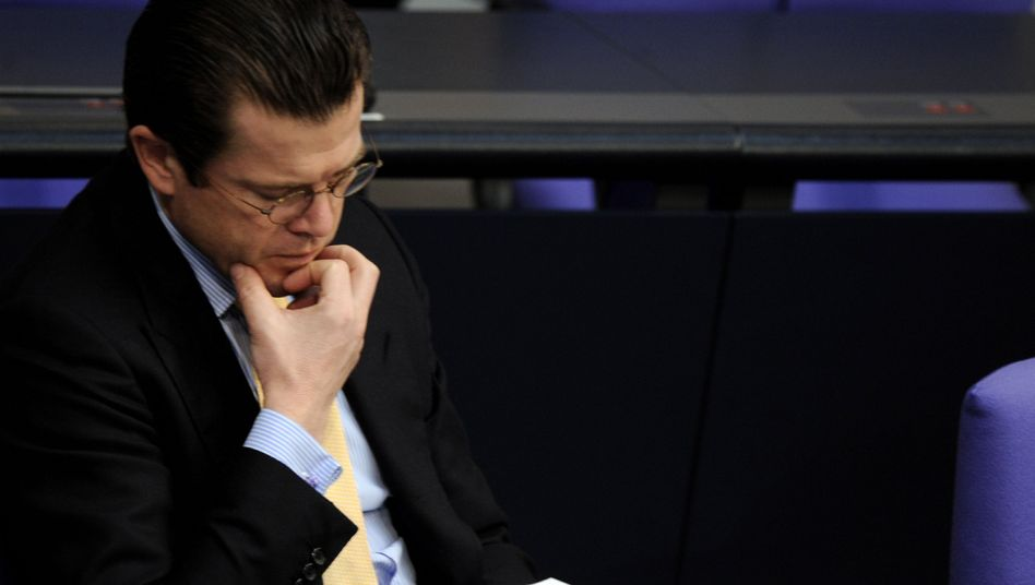 German Defense Minister Karl-Theodor zu Guttenberg may not be out of the woods yet.