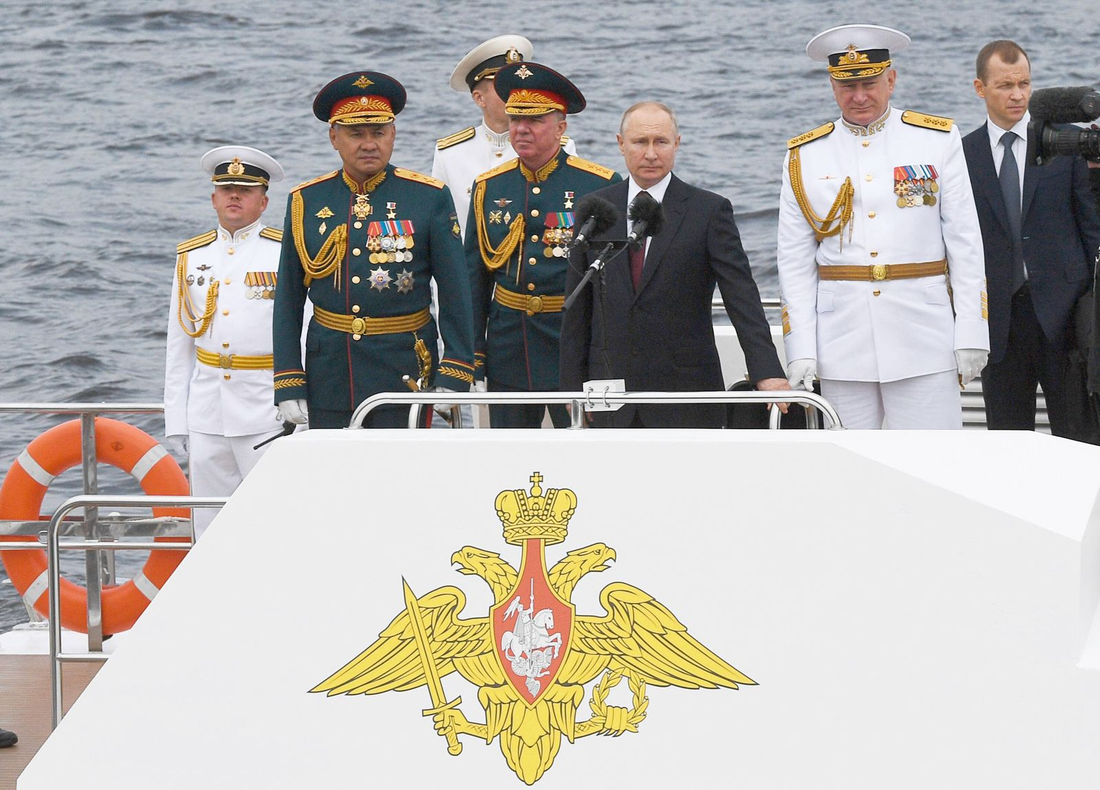 ST PETERSBURG, RUSSIA - JULY 25, 2021: Russia s President Vladimir Putin (C) watches the main naval parade on Russian N
