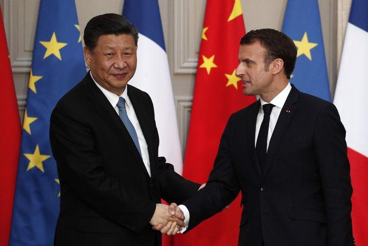 Chinas Staatschef Xi Jinping und Frankreichs Präsident Emmanuel Macron