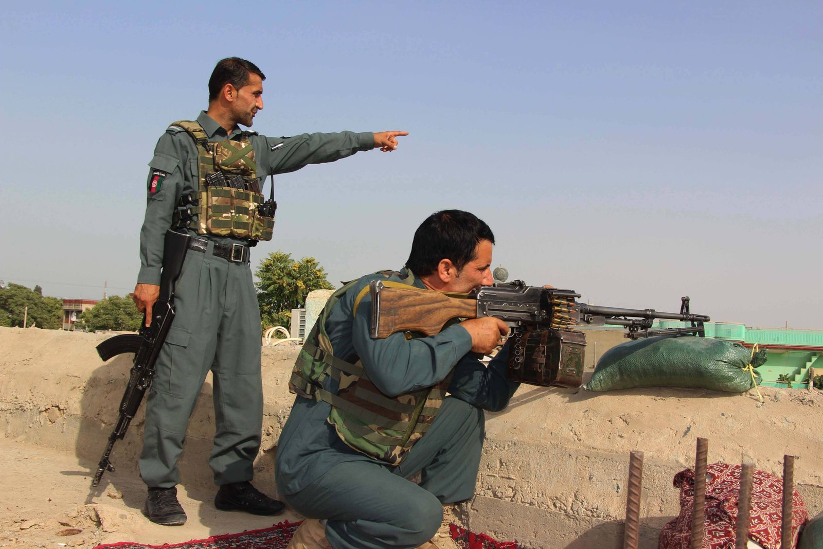 (210718) -- KUNDUZ, July 18, 2021 -- Afghan security force members take part in a military operation against Taliban mil