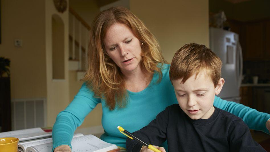 """Schüler mit """"teaching assistant"""" (umgangssprachlich: Mutter)"""