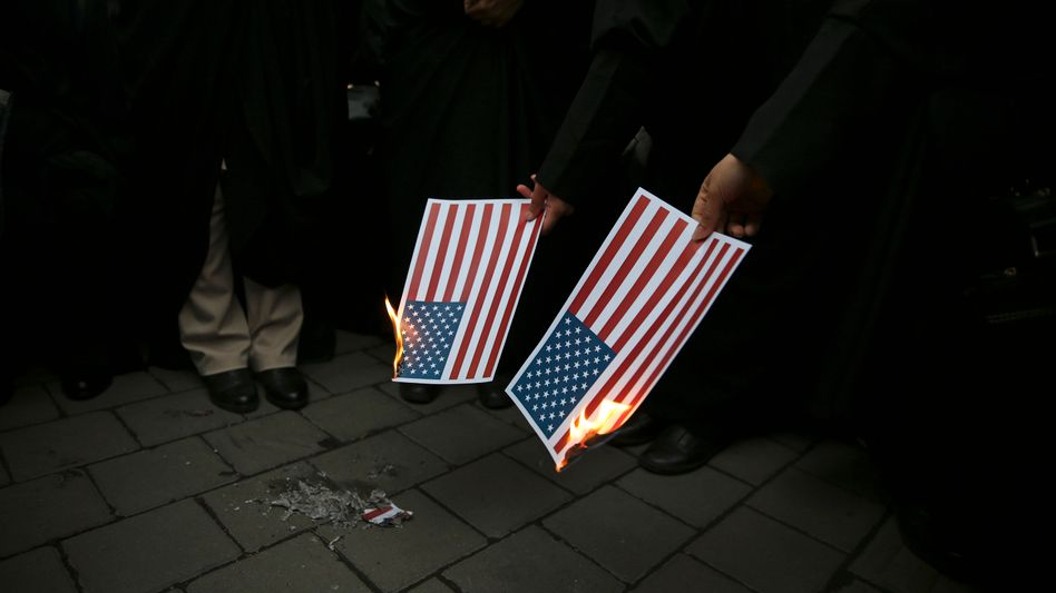 Iranian protesters burning U.S. flags after Donald Trump announced his withdrawal from the Iran nuclear deal.