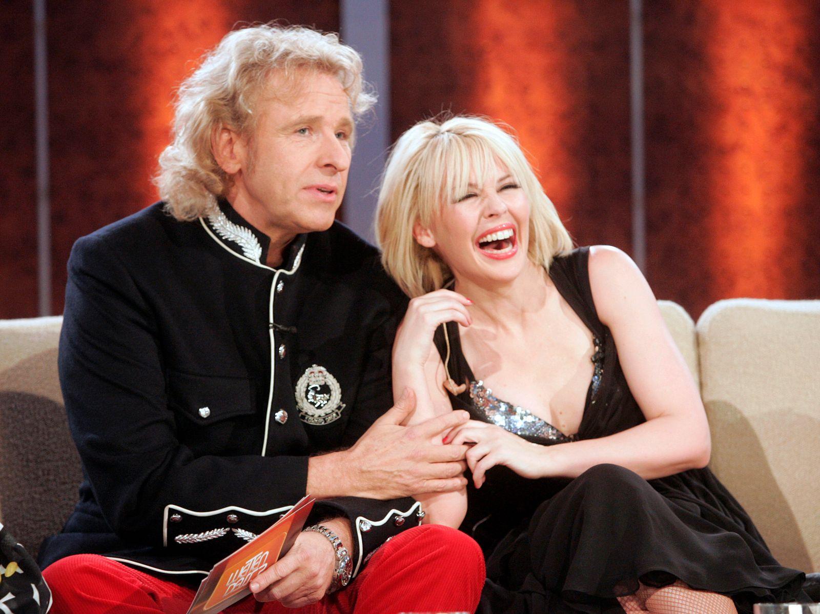 "Entertainer Gottschalk and singer Minogue share a joke during the TV Show ""Wetten Dass"" in Graz"