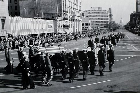 A military honor guard escorts the cortege bearing President John F. Kennedy's casket from the White House to the U.S. Capitol for viewing on November 24, 1963.