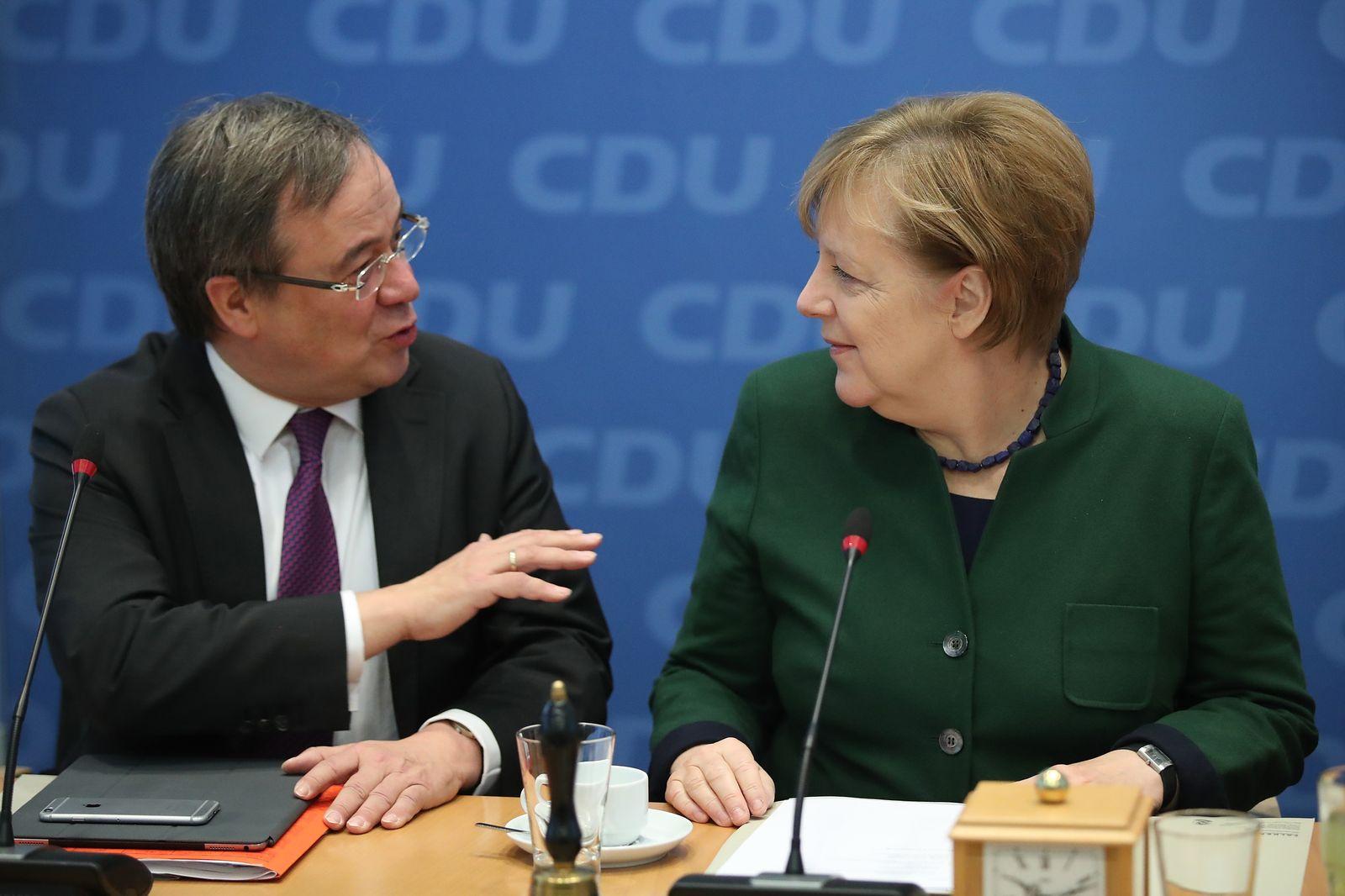 Laschet/ Merkel