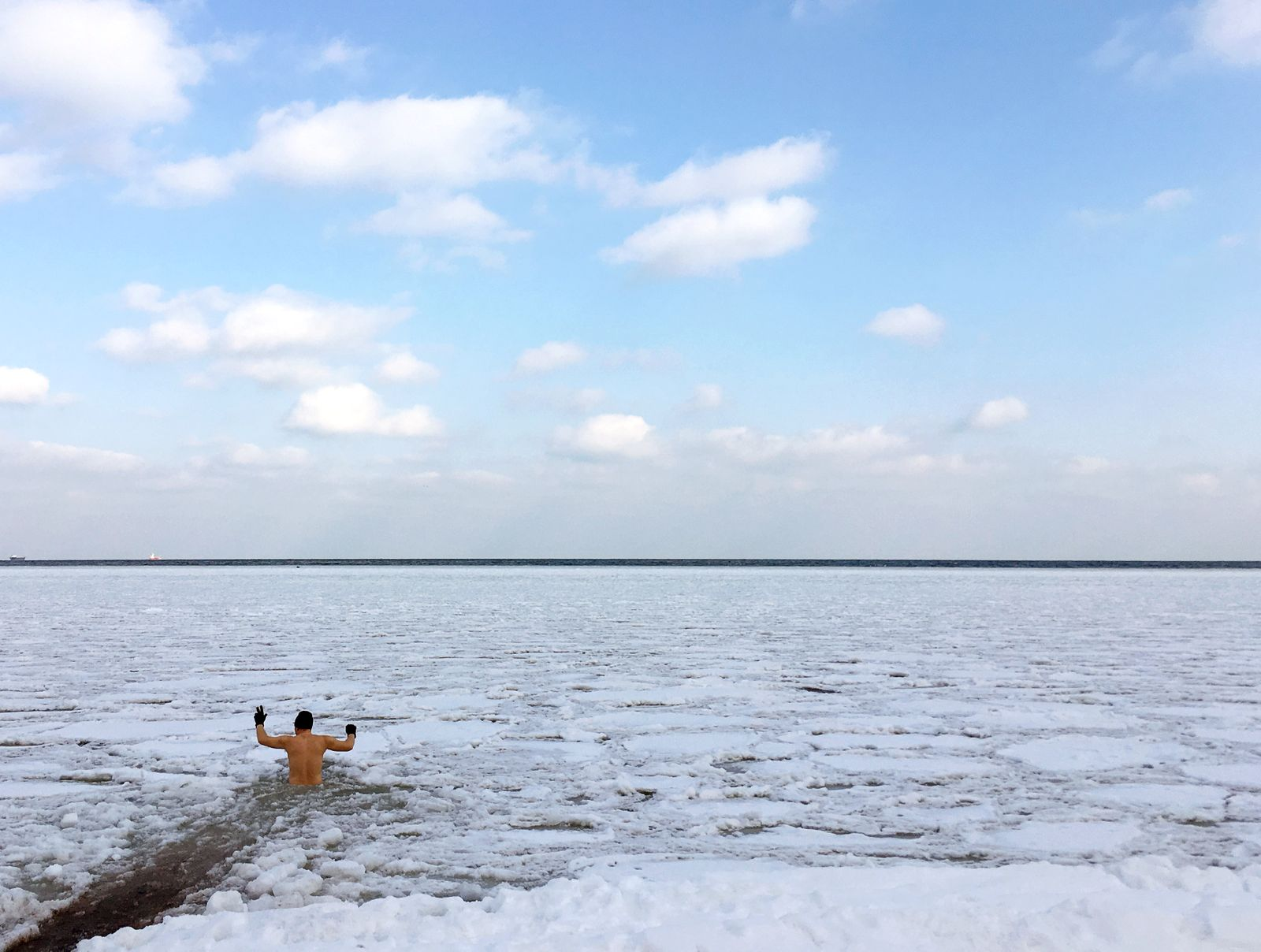 A man takes a bath in partly frozen Baltic sea in Gdynia