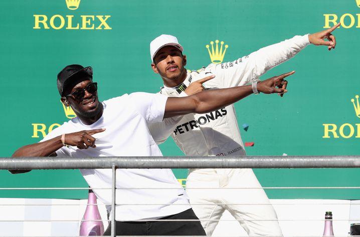 Usain Bolt (l.) und Lewis Hamilton