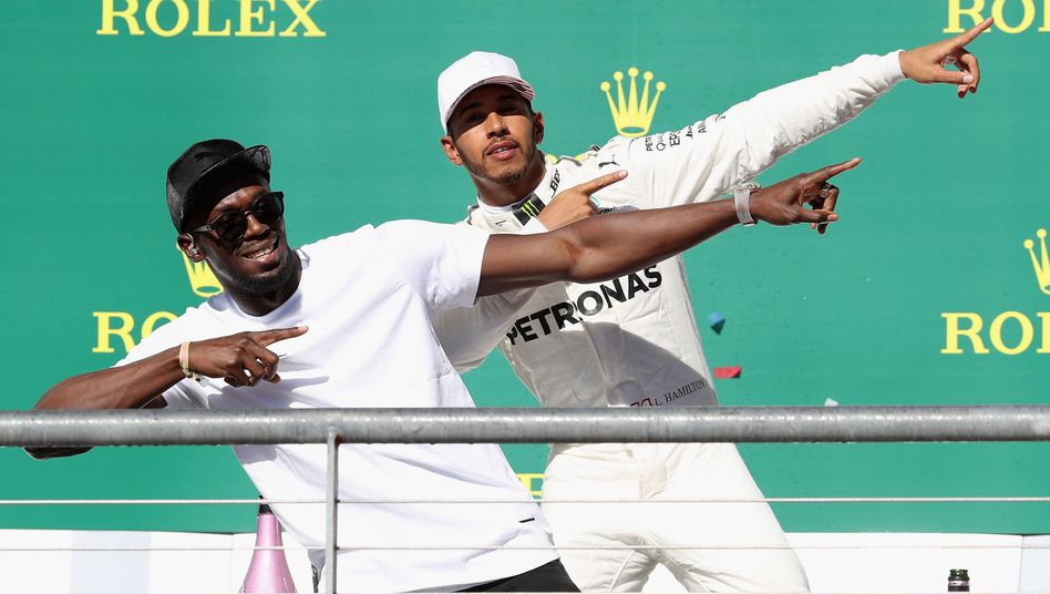 F1-Pilot Lewis Hamilton (r.), Sprinter Usain Bolt