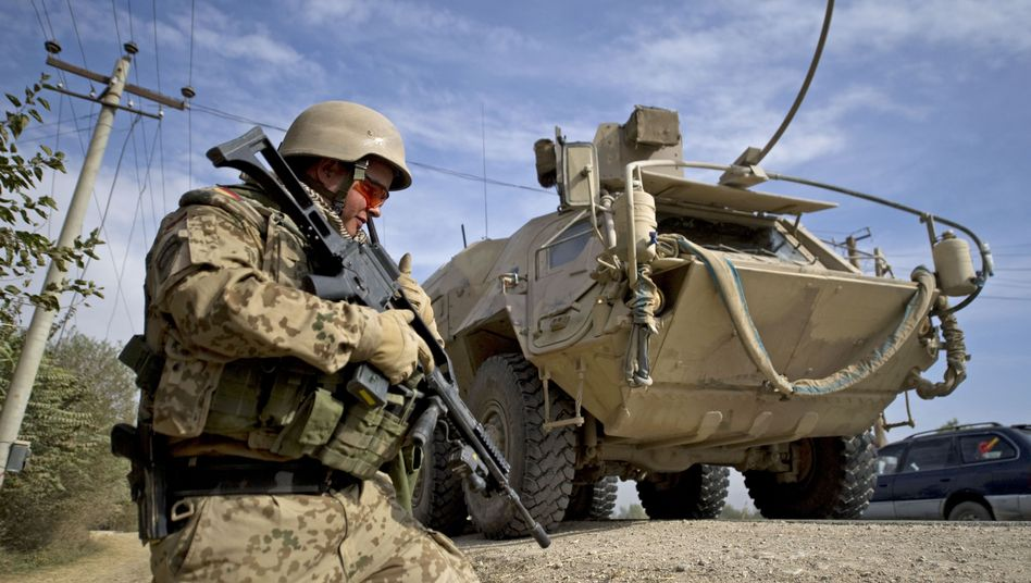 A German soldier on patrol in Chuluza, Afghanistan.
