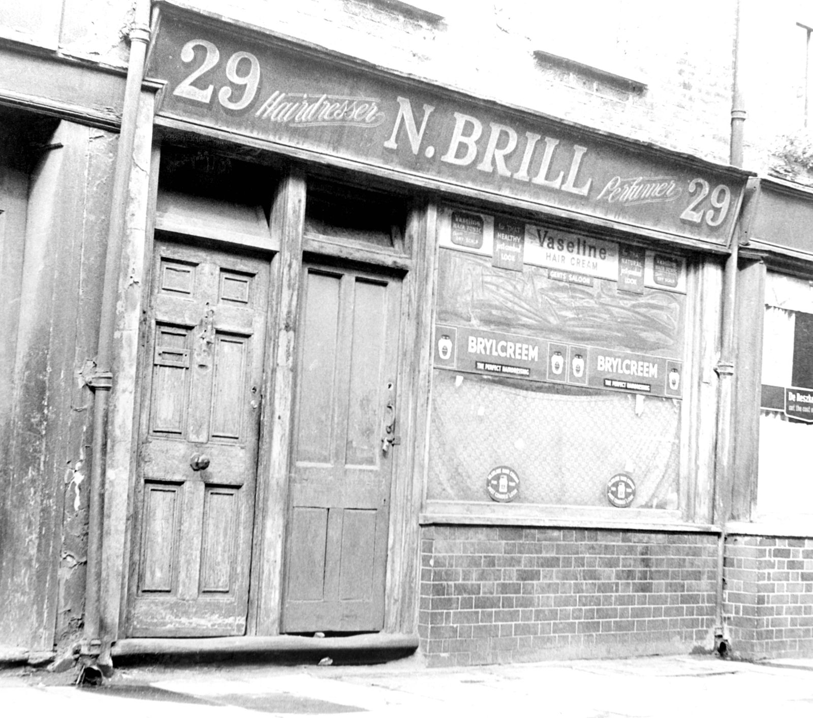 This is a 1963 picture of the disused barbershop in Hanbury Street Steoney East London In the bac