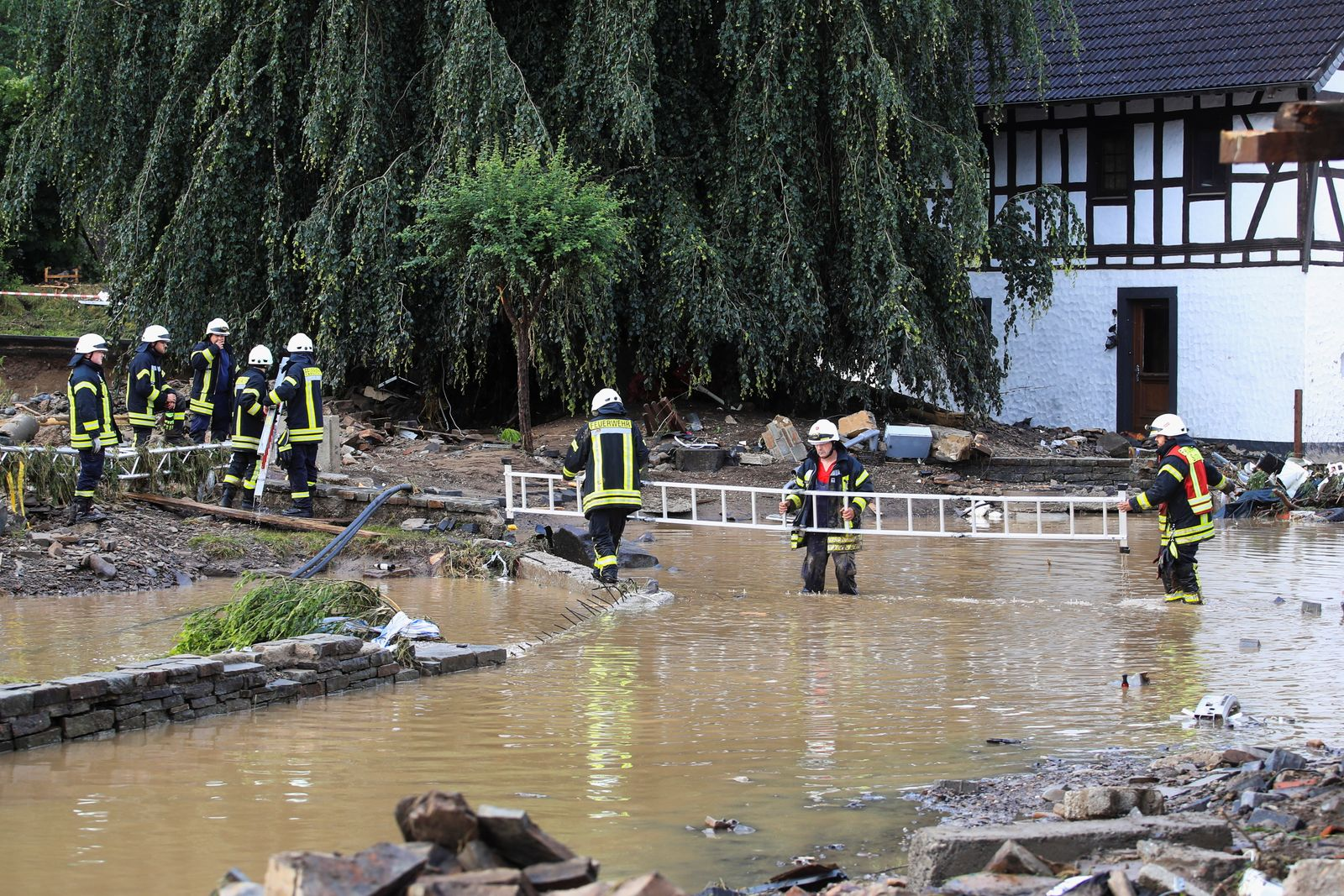 Firefighters work at a flood-affected area following heavy rainfalls in Schuld