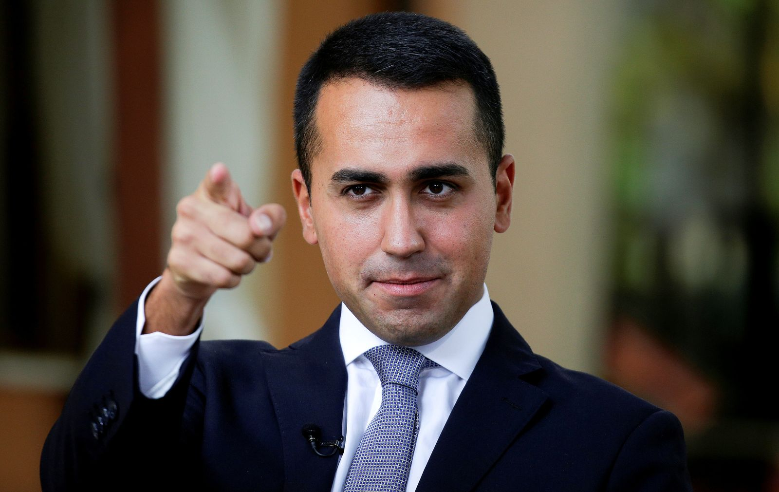 FILE PHOTO: 5-Star new leader Di Maio gestures during an interview with journalists in Rimini