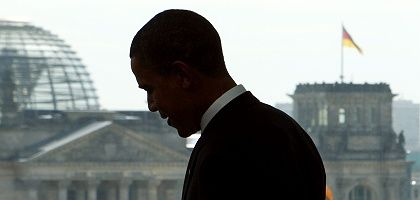 Germany meets the Superstar: US presidential candidate Barack Obama stands facing the Reichstag in Berlin.