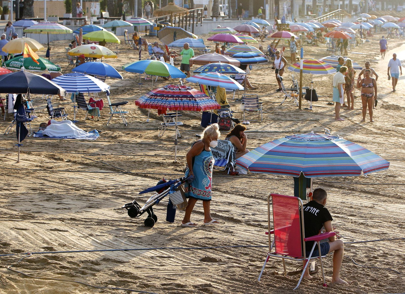 Sunbathers have to keep distance on beach in Torrevieja