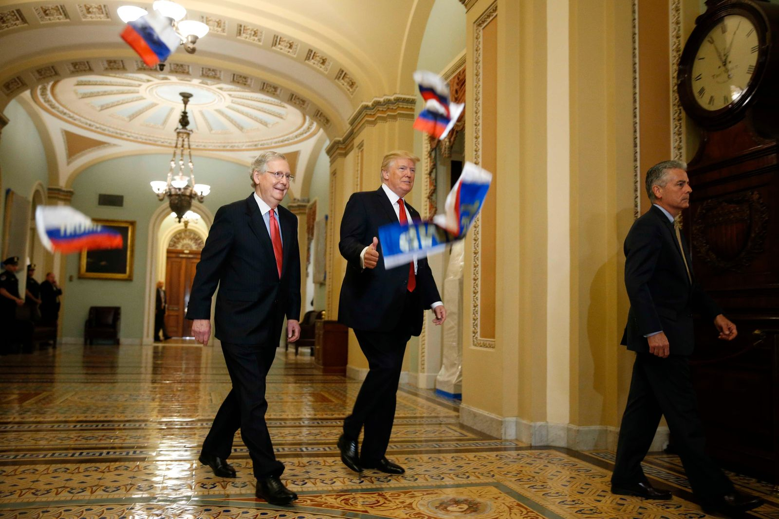 U.S. President Trump walks with McConnell as he arrives for Senate Republican Policy Committee's weekly policy luncheon meeting on Capitol Hill in Washington