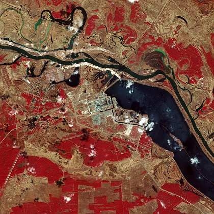 An aerial spectral image of the Chernobyl disaster zone. The red areas indicate vegetation.