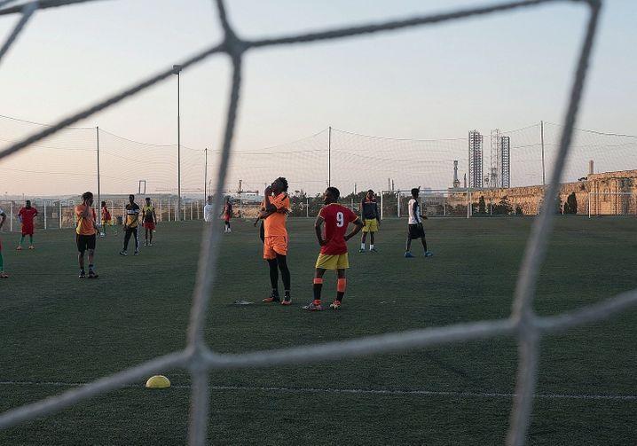Abdalla and Lamin playing soccer