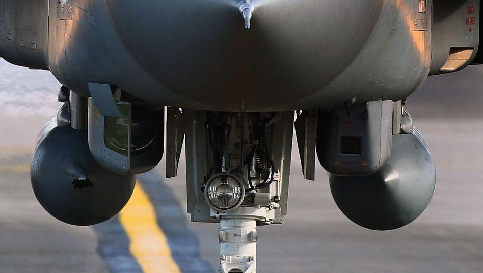 A pilot lands an RAF Tornado at Lossiemouth Air Base in Scotland.