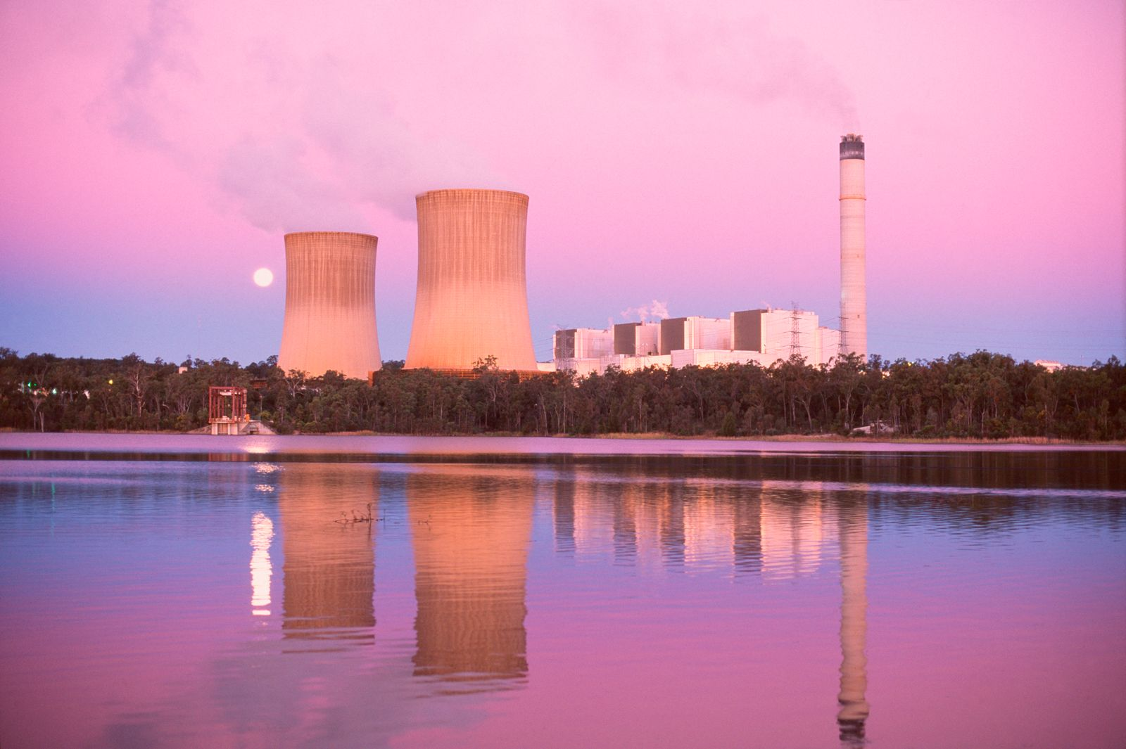 Water vapour and unseen oxides of carbon and other elements rise from a coal-fired power station, contributing to air pollution and greenhouse gases