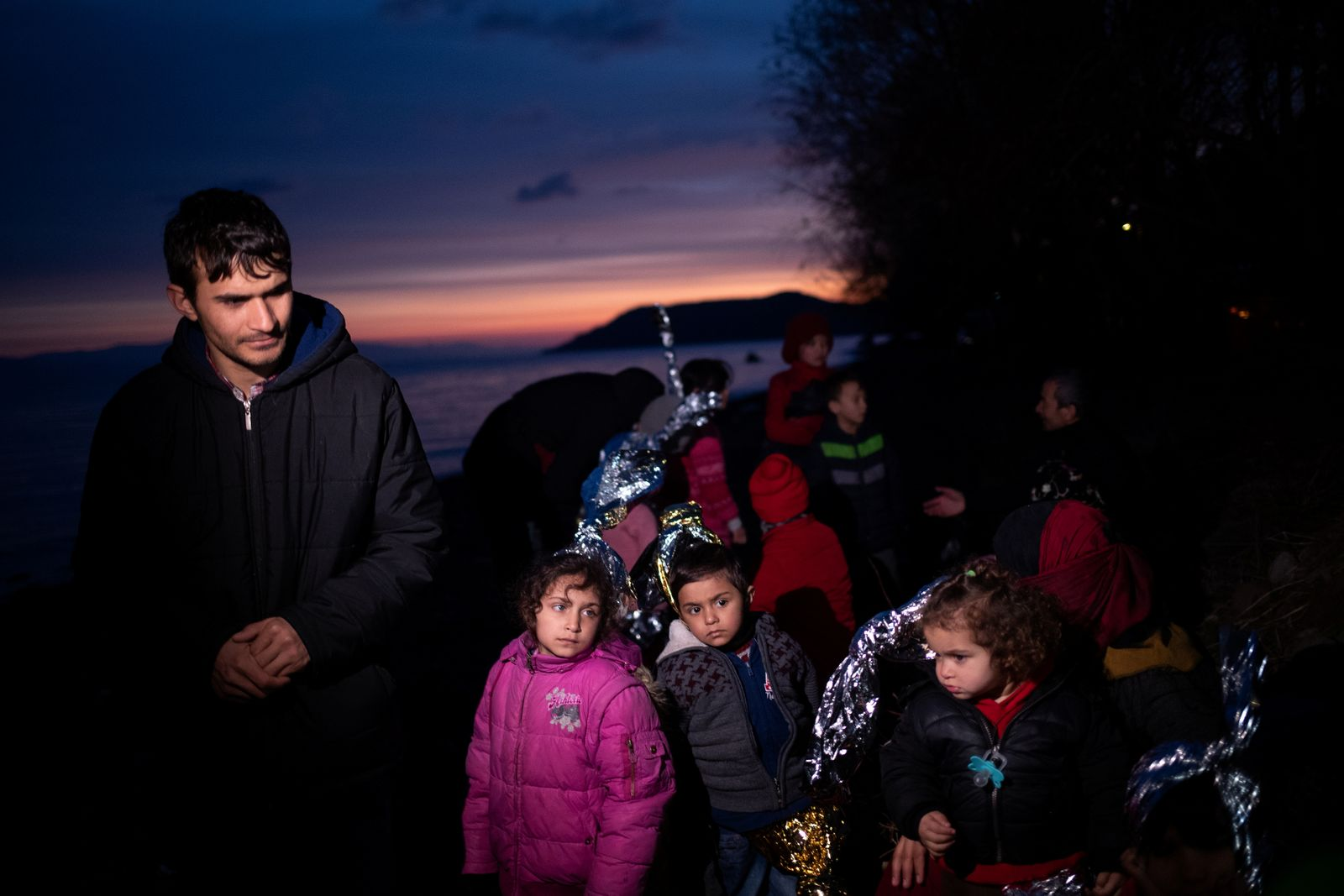 Migrants from Afghanistan are seen on a beach near the village of Skala Sikamias, after crossing part of the Aegean Sea from Turkey to the island of Lesbos