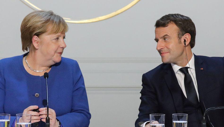 Angela Merkel, Emmanuel Macron (Archivfoto)