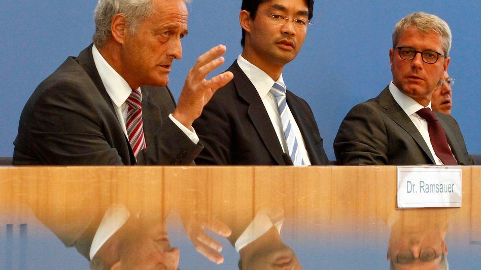 Minister Ramsauer, Rösler und Röttgen (v.l.n.r.): Regierung preist ihren Fahrplan