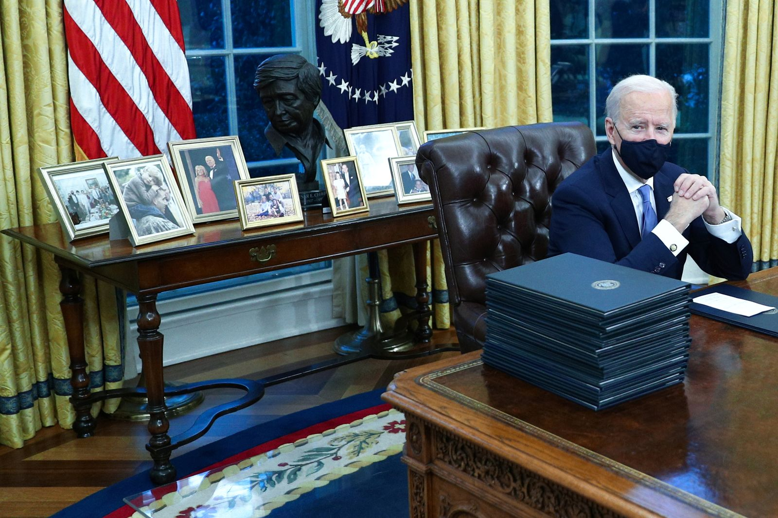 President Biden signs multiple executive orders inside the Oval Office in Washington