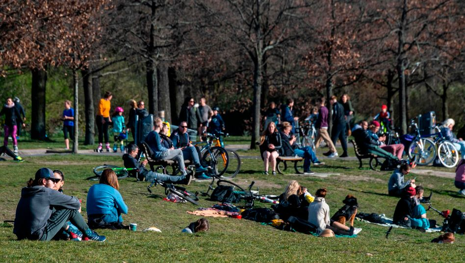 People have gathered in Berlin parks this week despite strict restrictions put in place due to the new coronavirus.