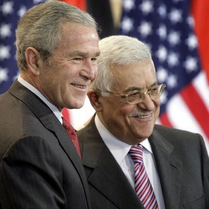 US President George W. Bush, left, with Palestinian President Mahmoud Abbas: A two-state solution within a year?