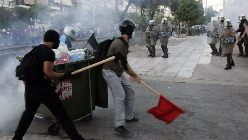 Greek protesters clash with police in Athens on Wednesday.