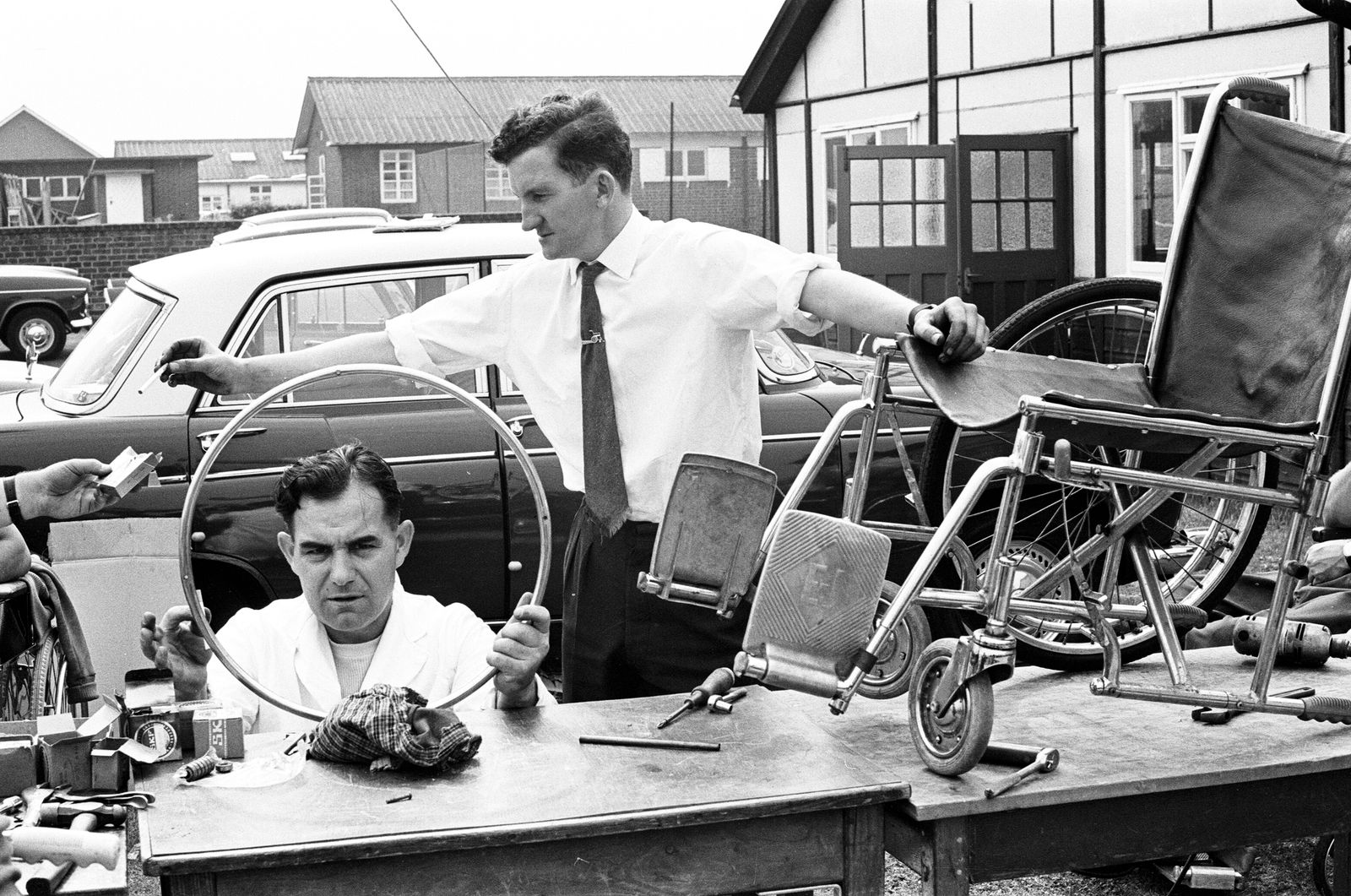 Engineers work on equipment for Paralympic Athletes training at Stoke Mandeville, ahead of the 1964 Paralympics to be held in Tokyo, pictured 22nd July 1964.