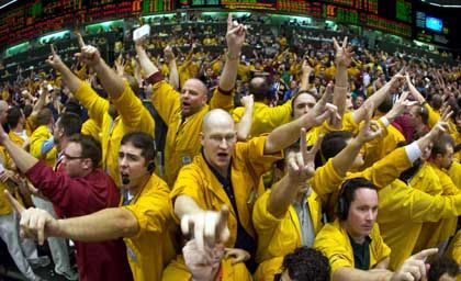 Traders at the Chicago Mercantile Exchange. Financial and commodities markets have been surging, but the party may be over soon.