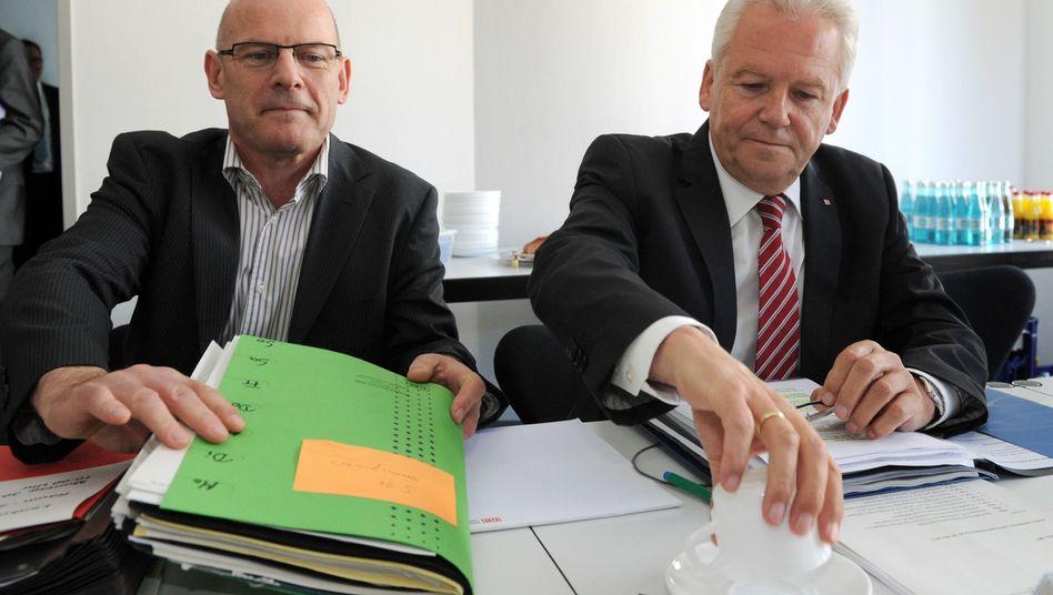 Verkehrsminister Hermann, Bahnchef Grube (Archivbild vom Mai): Hilft Geißlers Vorschlag?