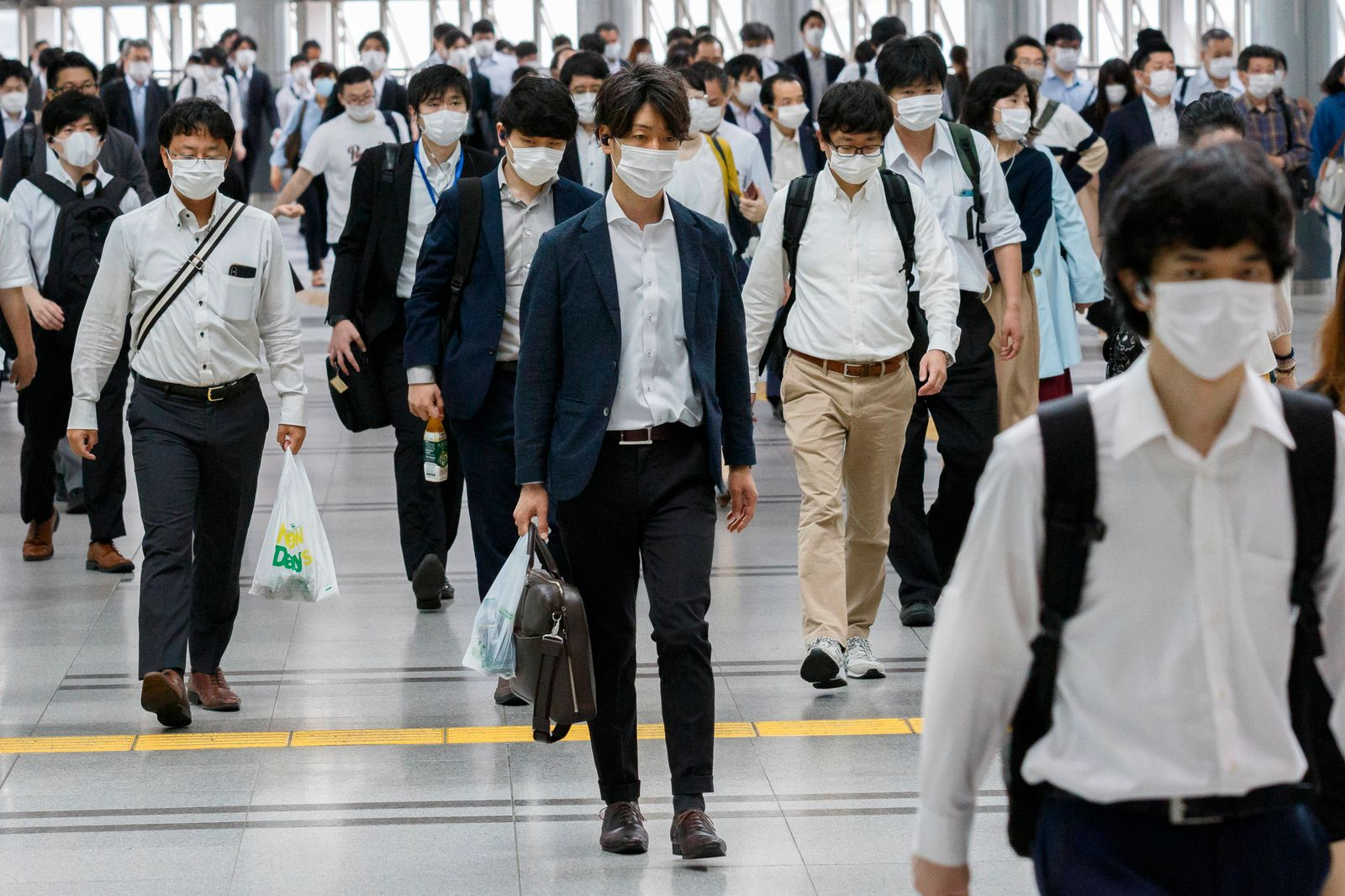 May 26, 2020, Tokyo, Japan: Commuters wearing face masks walk from Shinagawa Station to their offices, a day after Prim