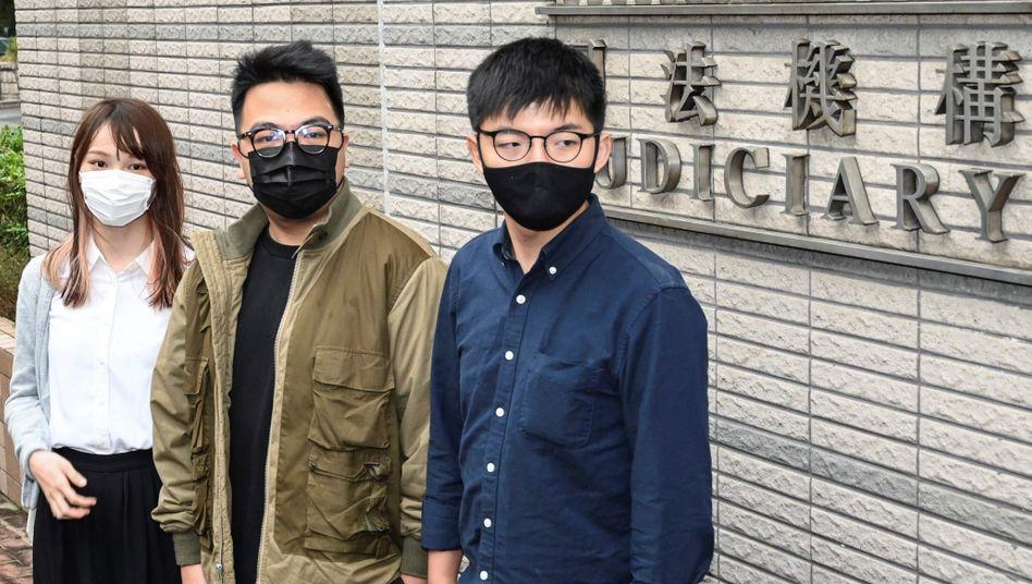 Aktivisten Agnes Chow, Ivan Lam und Joshua Wong