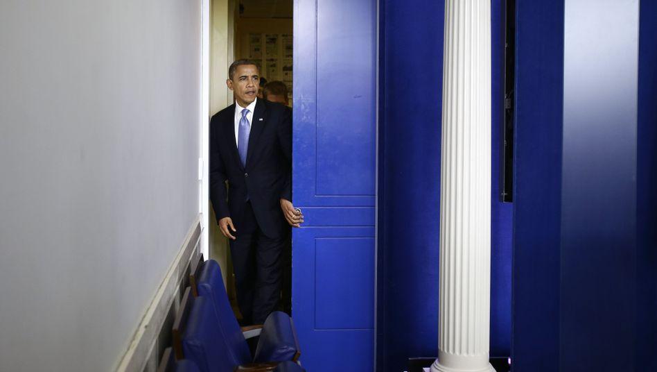 President Obama prepares to brief reporters on Hurricane Sandy in Washington on Monday.
