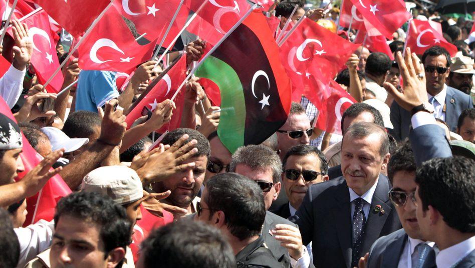 """Recep Tayyip Erdogan in Libyen (2011): """"Wir geben ihnen die Unterstützung, die sie brauchen."""""""