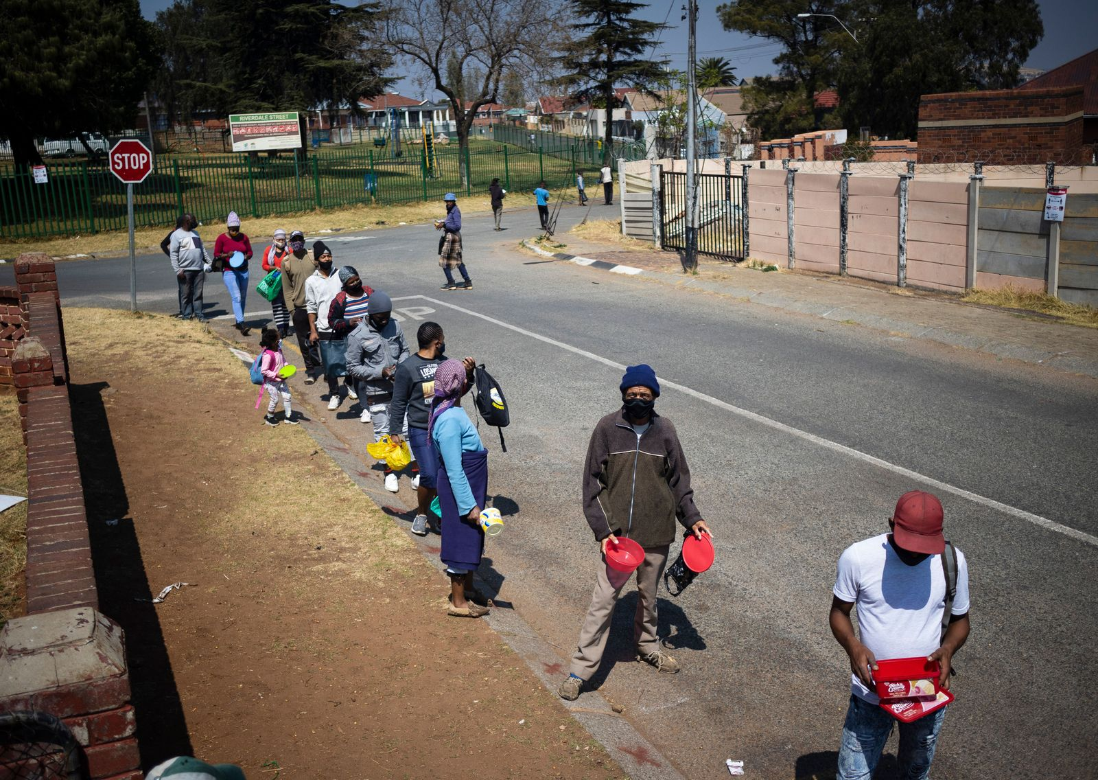 South Africa covid-19 lockdown food handout, Johannesburg - 03 Sep 2020