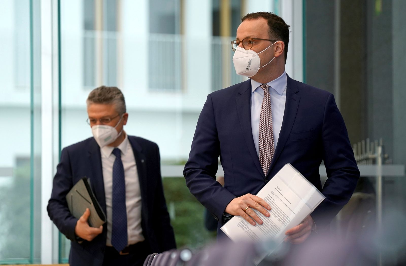 German Health Minister Jens Spahn and Lothar H. Wieler president of the Robert-Koch-Institute German national agency and research institute, responsible for disease control and prevention, arrive for a press conference in Berlin