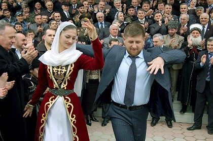 "Dancing doctor? Ramzan Kadyrov, seen here celebrating his appointment as Chechen President in March, earned a doctorate in the ""Optimal Management of Contractual Relationships in the Construction Industry."""